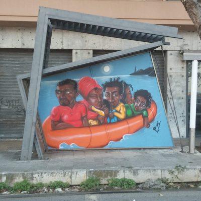 Immagine di uno dei murales di Messina con immigrati